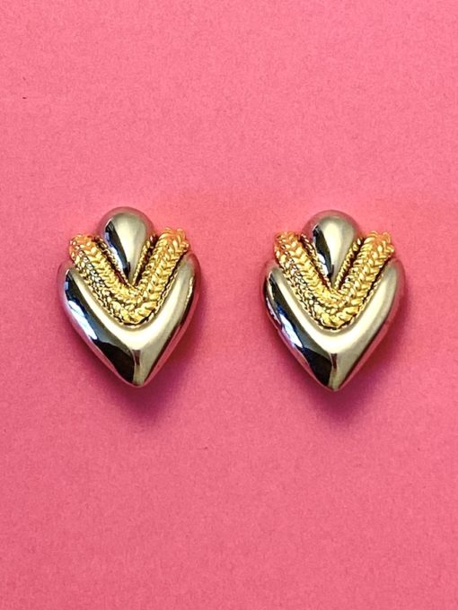 image shows a pair of 1980s Vintage Earrings Silver & Gold