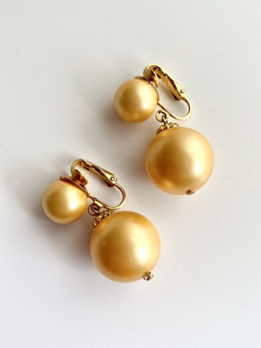 image of a pair of Vintage 1960s Earrings in Peach deadstock white background
