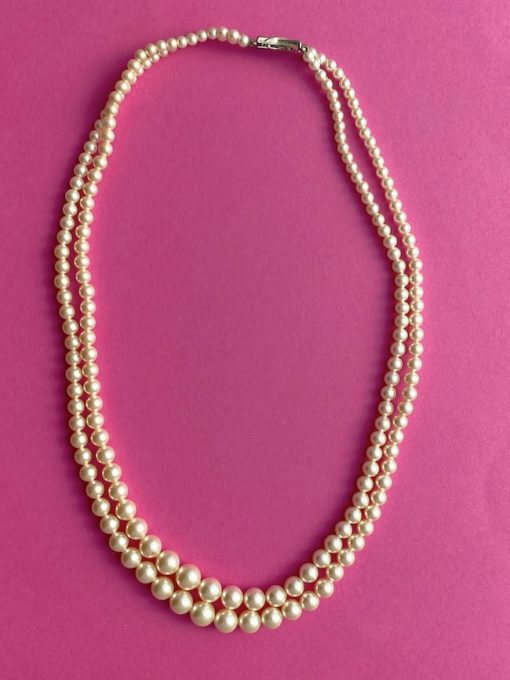image shows a Vintage Glass Pearl Necklace form above
