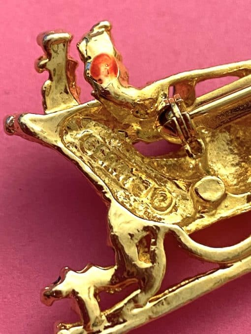 image of a vintage brooch depicting a sleigh and horse, showing the back where it is signed Gerrys